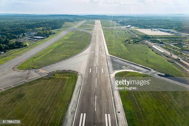 aerial view of airplane landing strip - airfield stock pictures, royalty-free photos & images