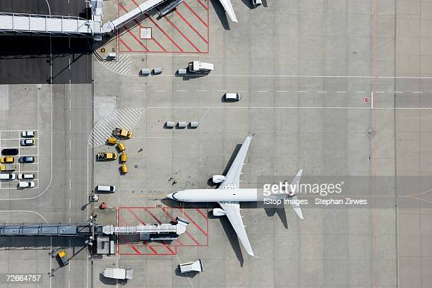 aerial view of airplane - passenger boarding bridge stock pictures, royalty-free photos & images