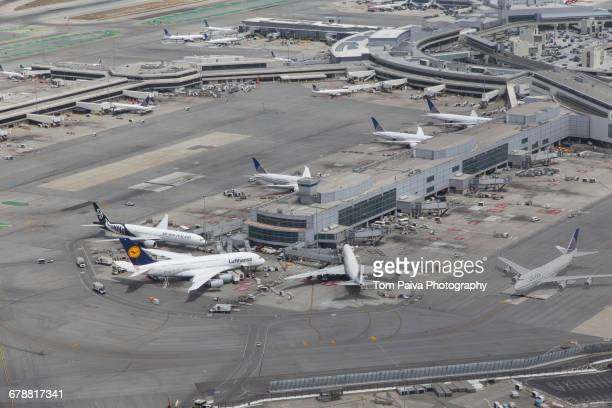 Aerial view of airplanes at airport terminal