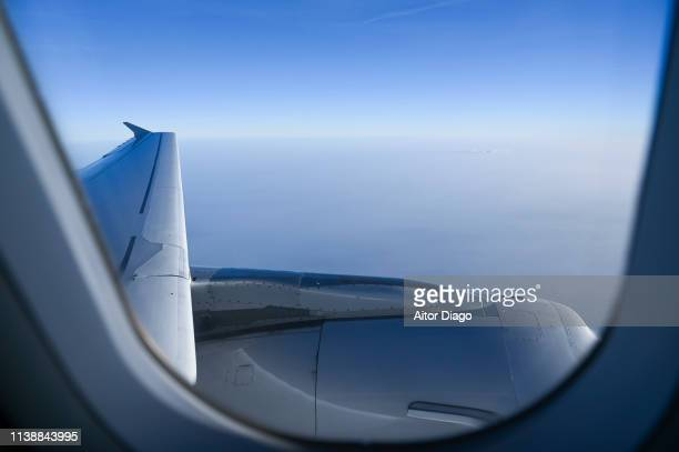 aerial view of airplanes wing. - gliding stock pictures, royalty-free photos & images