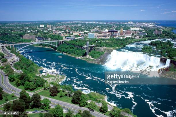 aerial view of american falls and rainbow bridge, niagara falls, new york, usa, viewed from the canadian side of the niagara river, ontario, canada - niagara river stock pictures, royalty-free photos & images