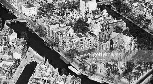 Aerial view of Amsterdam, and the house Anne Frank hid in. The house, located along the canal on the left, is outlined.