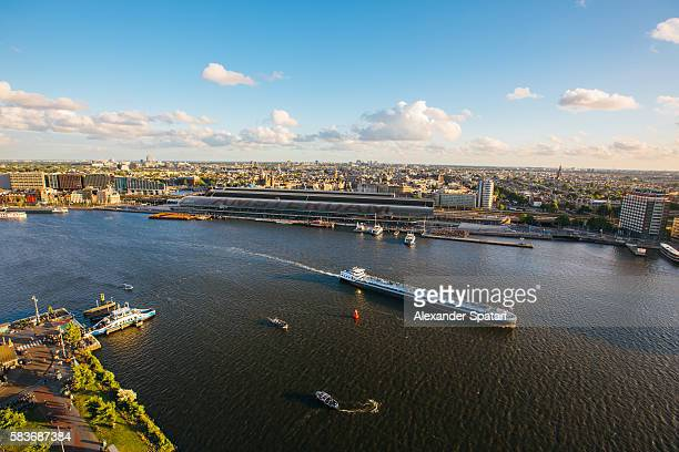 Aerial view of Amsterdam cityscape with Central Station in the center, Netherlands