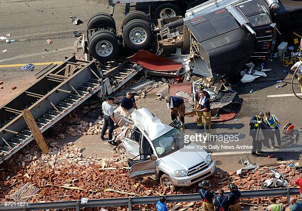Aerial view of an accident scene on the New Jersey Turnpike which claimed four lives after a tractortrailer truck hauling bricks spun out and...