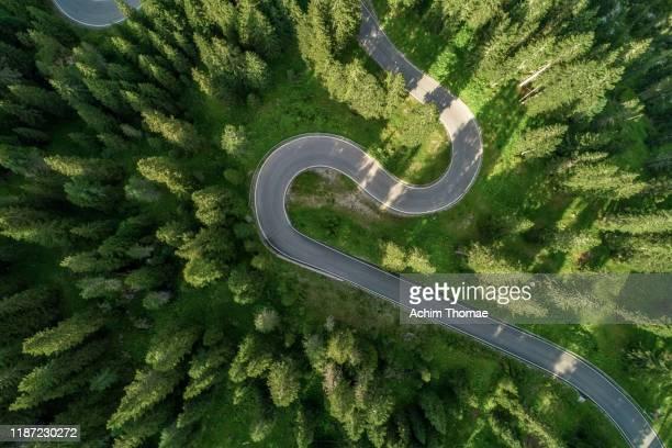aerial view of an alpine road - clima alpino foto e immagini stock