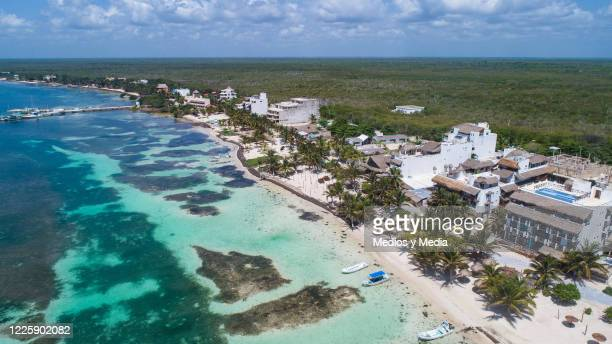 Aerial view of an empty beach and brown spots due to the Sargasso on May 19 2020 in Mahahual Quintana Roo Mexico Despite the growing number of...