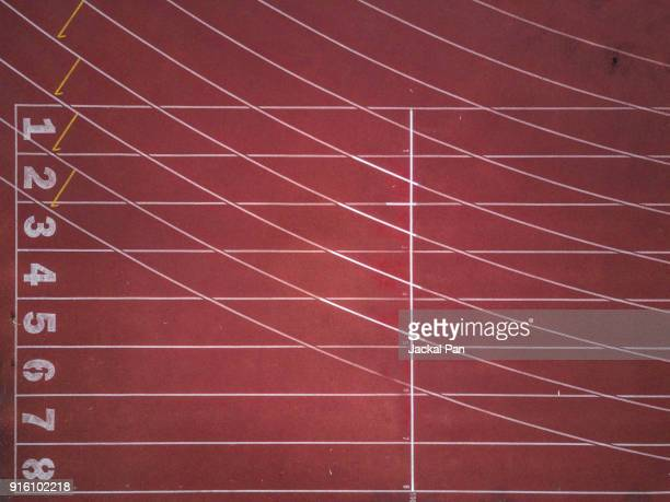 aerial view of an empty track and field stadium - athletics stock photos and pictures