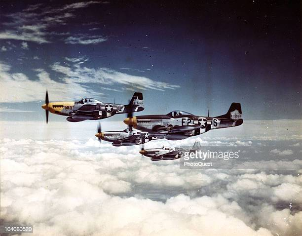Aerial view of an escort of North American Aviation P51 Mustang fighter planes in flight over France July 20 1944