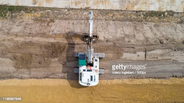 aerial view of an excavator on a construction site - ブルドーザー ストックフォトと画像