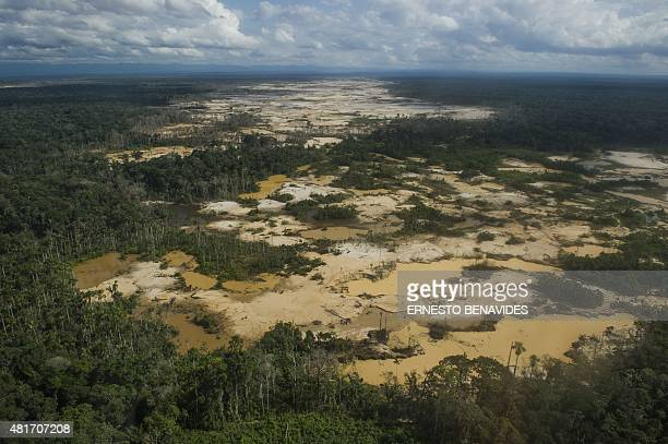 Aerial view of an illegal gold mining area in La Pampa Madre de Dios southern Peruvian jungle on July 14 2015 In an unprecedented operation in...