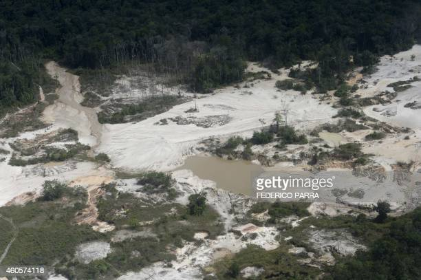 Aerial view of an illegal mine located in Canaima National Park Bolivar State Gran Sabana Region SouthEastern Venezuela on December 16 2014 AFP...