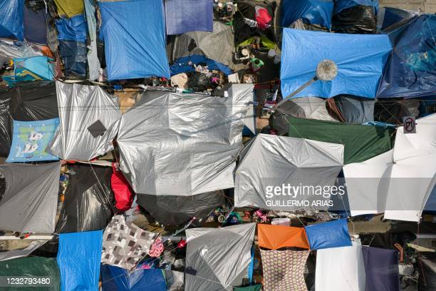 Aerial view of an improvised migrants and asylum seekers camp outside El Chaparral crossing port as they wait for US authorities to allow them to...