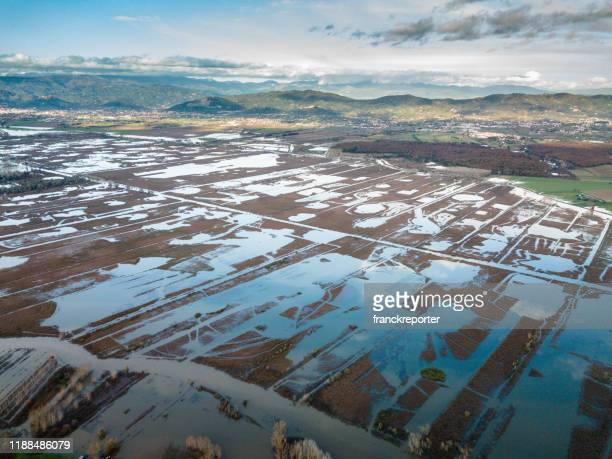 aerial view of an italian countryside after the flooding - europa meridionale foto e immagini stock