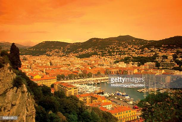 aerial view of an old port and town at sunset, nice, france - nice frankrijk stockfoto's en -beelden