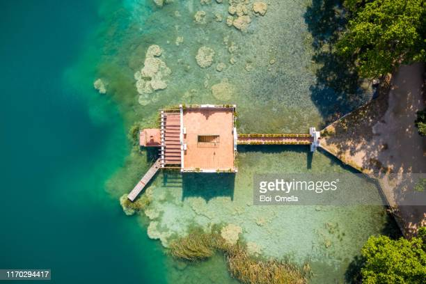 aerial view of ancient fishing house in estany de banyoles lake - banyoles stock pictures, royalty-free photos & images