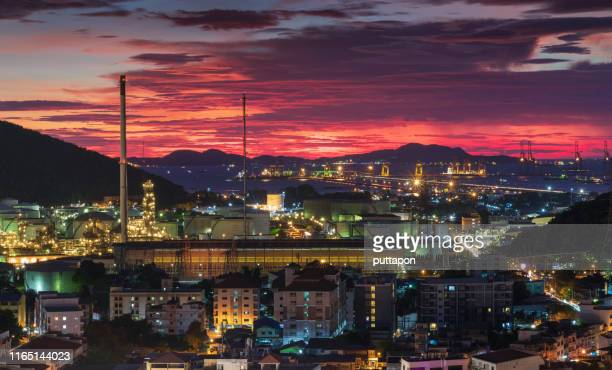 aerial view of and oil refinery at sunset time and container ship in import export and business logistic, shipping cargo to harbor, international transportation, business logistics concept - chonburi province stock pictures, royalty-free photos & images