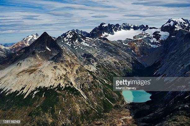 Aerial view of Andes mountains in Tierra del Fuego, Land of Fire. Named so by the first explorer Magallanes, after seeing smoke rising from indiginous fires on the shores. Tierra del Fuego National Park, Argentina