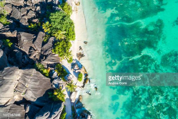 aerial view of anse source d'argent beach at sunset - southern africa stock pictures, royalty-free photos & images