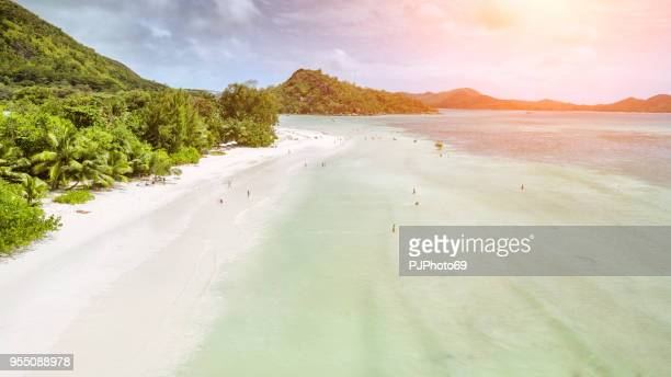 Aerial view of Anse Volbert with tourists - Praslin - Seychelles