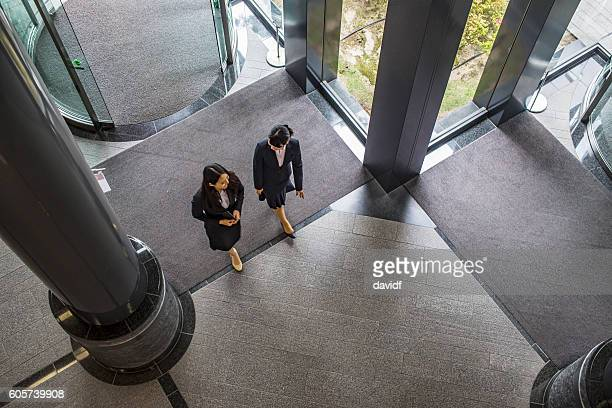 Aerial View of Asian Business Women Entering Office Building Lobby