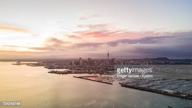 aerial view of auckland city waterfrontagainst cloudy sky - auckland stock pictures, royalty-free photos & images