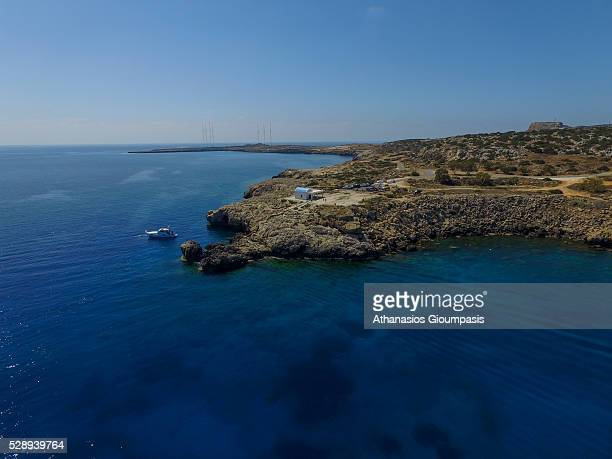 Aerial view of Ayii Anargyri chapel at Cape Greco and the sea caves with turquoise waters on April 29 2016 in Larnaca Cyprus Cape Greco or Cavo Greco...