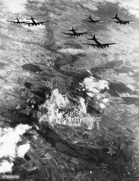 Aerial view of B17 Fortress bombers of the US 8th Air Force plastering another Nazi fighter base at the AmiensGlisy aerodrome in Northern France at...