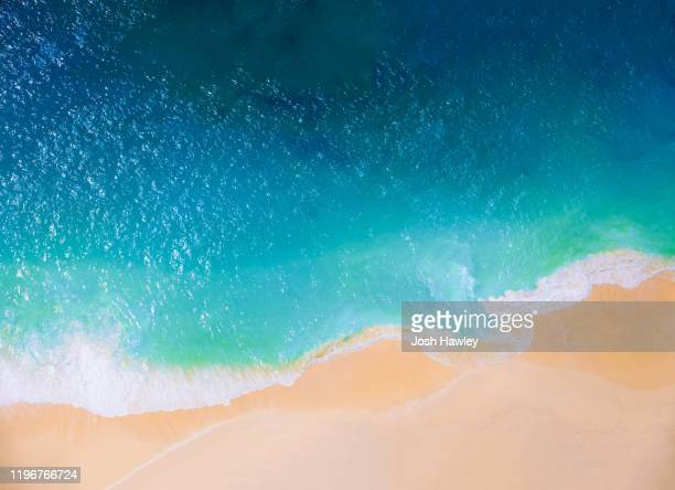 aerial view of bali beach - water's edge stock pictures, royalty-free photos & images