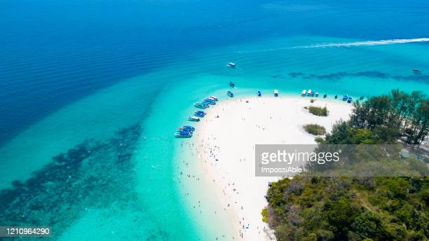 aerial view of bamboo island or koh mai phai with tourboat and tourist, andaman sea, krabi, thailand - impossiable stock pictures, royalty-free photos & images