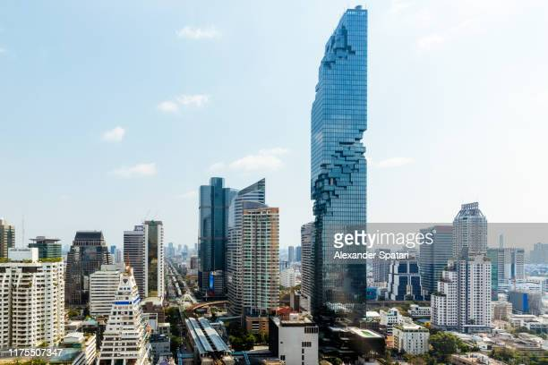 aerial view of bangkok cityscape with futuristic skyscrapers - bangkok stock pictures, royalty-free photos & images