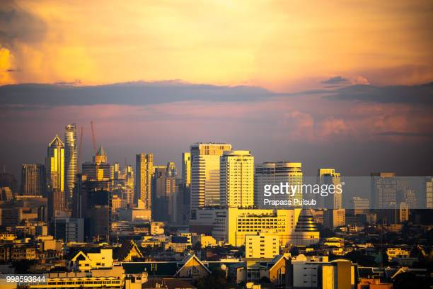 Aerial view of Bangkok modern office buildings, condominium in Bangkok city downtown with sunset sky , Bangkok , Thailand
