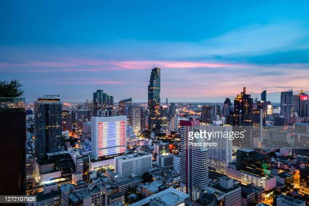 aerial view of bangkok modern office buildings, condominium in central business downtown during twilight time at bangkok , thailand. - シーロム ストックフォトと画像