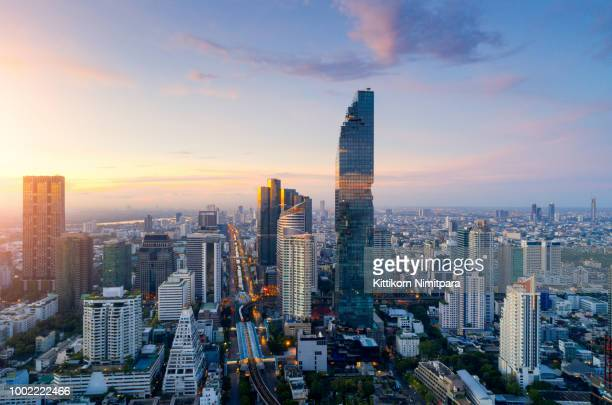 aerial view of bangkok modern office buildings, condominium, living place in bangkok city downtown with sunset scenery, bangkok is the most populated city in southeast asia.bangkok , thailand - バンコク ストックフォトと画像
