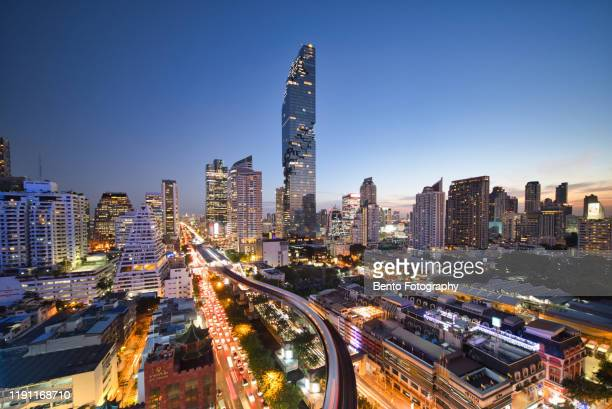 aerial view of bangkok modern office buildings, condominium, living place in bangkok city downtown with sunset scenery, thailand - bangkok stock pictures, royalty-free photos & images