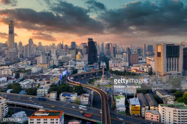 aerial view of bangkok modern office buildings, condominium, living place in bangkok city downtown with sunset scenery, bangkok is the most populated city in southeast asia.bangkok , thailand. - バンコク・スカイトレイン ストックフォトと画像
