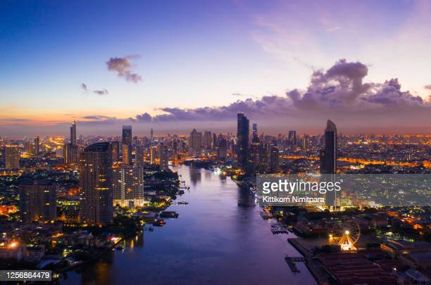 aerial view of bangkok modern office buildings, condominium, living place in bangkok city downtown with sunset scenery, bangkok is the most populated city in southeast asia.bangkok , thailand - bangkok stock pictures, royalty-free photos & images