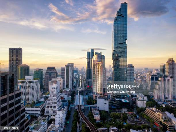 Aerial view of Bangkok skyline and skyscraper on Silom road center of business in capital. Modern city and BTS skytrain with Chao Phraya river at Bangkok Thailand on sunrise
