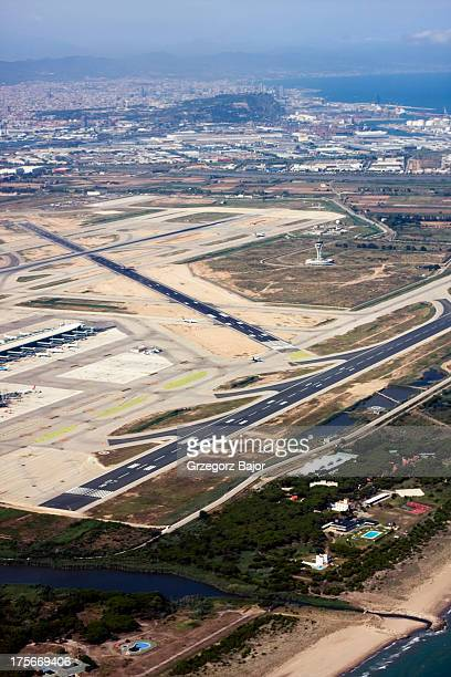 CONTENT] Aerial view of Barcelona El Prat Airport with the city in the distance view Barcelona Catalonia Spain