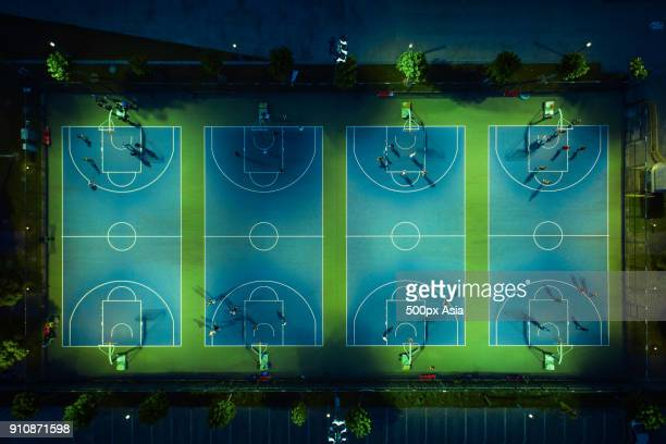 aerial view of basketball courts with players at night, shanghai, china - image stock pictures, royalty-free photos & images