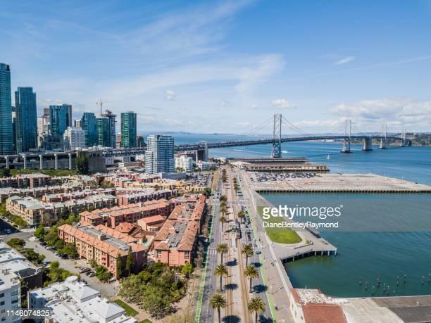 aerial view of bay bridge from embarcadero - san francisco bay bridge stock pictures, royalty-free photos & images