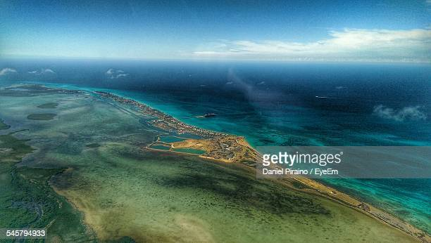 aerial view of beach against sky - bimini stock photos and pictures