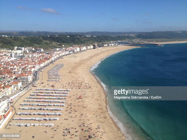aerial view of beach against sky - nazar stock photos and pictures