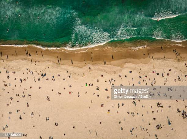 aerial view of beach during sunny day - aerial view stock pictures, royalty-free photos & images