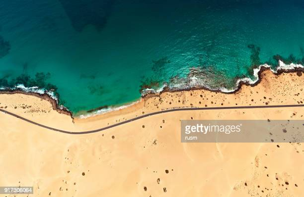 aerial view of beach in corralejo park, fuerteventura, canary islands - coastline stock photos and pictures