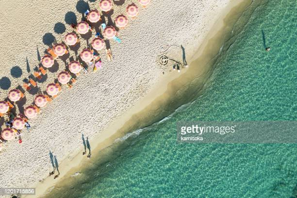 aerial view of beach in italy with parasols - cultura italiana foto e immagini stock