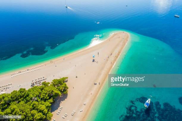 aerial view of beach on peninsula in croatia, bol, zlatni rat - croatia stock pictures, royalty-free photos & images