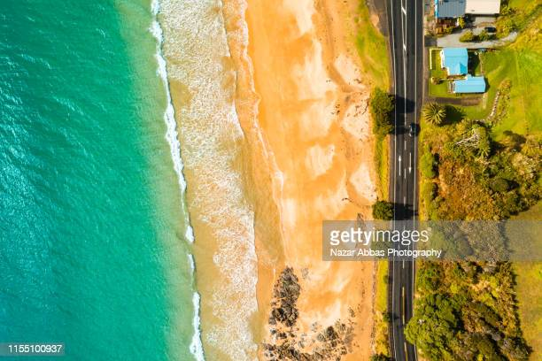aerial view of beach, road and houses. - nazar abbas photography stock pictures, royalty-free photos & images