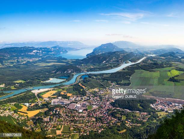 aerial view of beautiful french landscape in bugey mountains, in ain department auvergne-rhone-alpes region, with culoz small town, the rhone river and famous lake bourget in background in summer - auvergne rhône alpes stock pictures, royalty-free photos & images