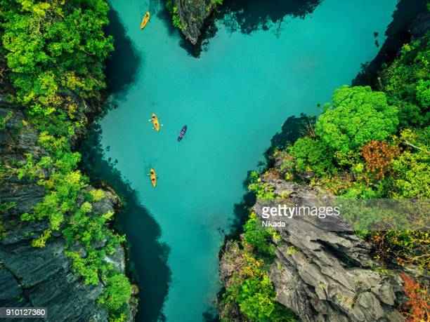 aerial view of beautiful lagoon with kayaks - el nido stock pictures, royalty-free photos & images