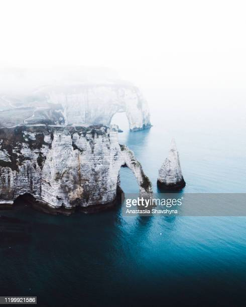 aerial view of beautiful natural big arch, cliff and the sea in etretat, france - sarthe stock pictures, royalty-free photos & images